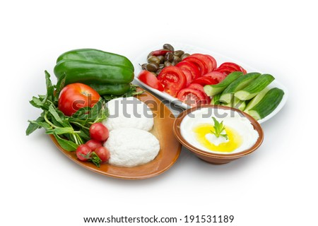 Lebanese food of Labneh Yogurt cheese and goat cheese  with veggies  - stock photo