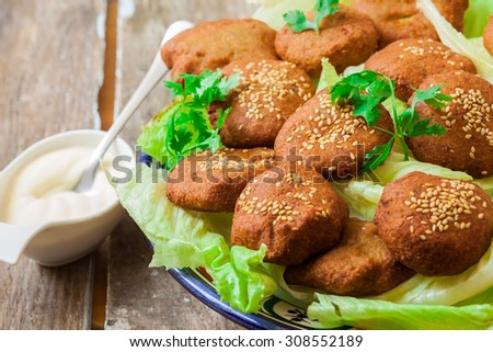 lebanese food with chickpeas deep fried falafel and salad with yougur sauce - stock photo
