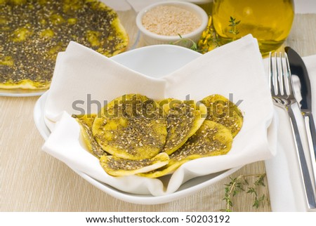 lebanese manouche or manoushe ,lebanese pizza with thyme and sesame seeds,zaatar, and extra virgin olive oil on top - stock photo