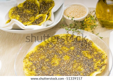 lebanese manouche or manoushe, lebanese pizza with thyme and sesame seeds,zaatar, and extra virgin olive oil on top - stock photo