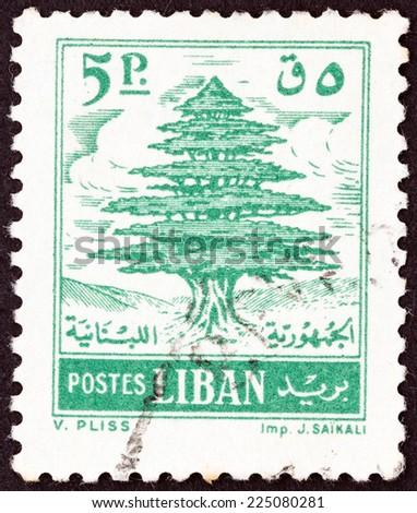 LEBANON - CIRCA 1960: A stamp printed in Lebanon shows Cedar of Lebanon, circa 1960.  - stock photo