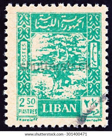 LEBANON - CIRCA 1947: A stamp printed in Lebanon shows Cedar of Lebanon, circa 1947.  - stock photo