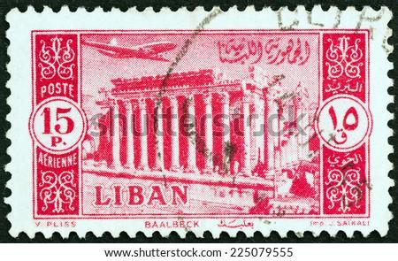 LEBANON - CIRCA 1954: A stamp printed in Lebanon shows Temple of Bacchus at Baalbek, circa 1954.  - stock photo