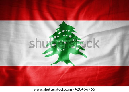 Lebanon flag on grunge fabric