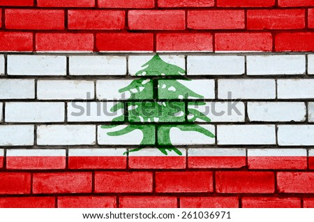 Lebanon flag painted on old brick wall texture background - stock photo