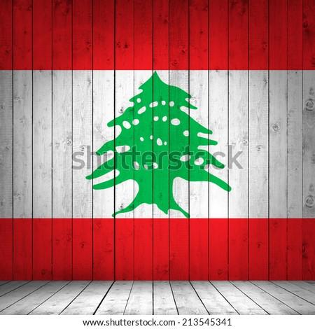 Lebanon flag with wood background - stock photo