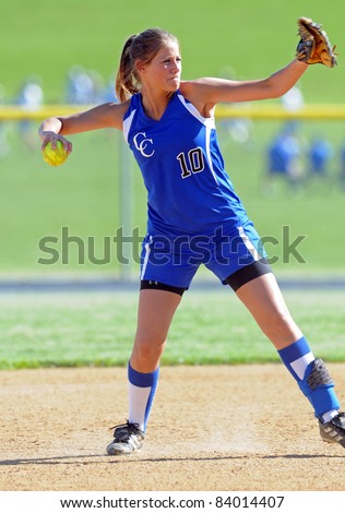 LEBANON, PA - MAY 9: Cedar Crest High School softball player Carly Weaber makes a throw on defense during a game against Manheim Township May 9, 2011 in Lebanon, PA - stock photo