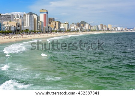 Leblon beach with its buildings by the sea forming a typical landscape of the coast of Rio de Janeiro - stock photo