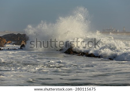Leca da Palmeira beach, north of Portugal, with rough sea in a beautiful sunny day. Flood tide. Surf point. - stock photo