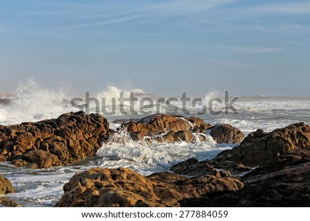 Leca da Palmeira beach, north of Portugal, with rough sea in a beautiful sunny day. Surf point. - stock photo
