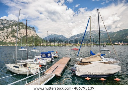 LECCO, ITALY - AUGUST 17, 2016: View of Lecco with boats at foreground
