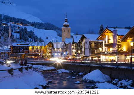 LECH, AUSTRIA - JANUARY 10, 2014: Lech is a popular ski resort and winter holiday destination in Europe; January 10, 2014, Lech, Austria - stock photo