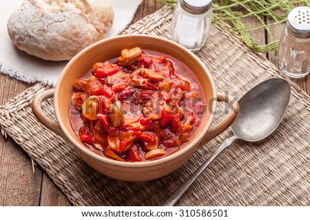Lecho - tasty Hungarian stew with peppers and sausage. - stock photo