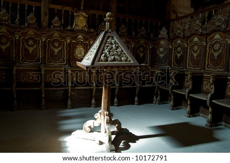 Lectern and pew of a cathedral choir - stock photo