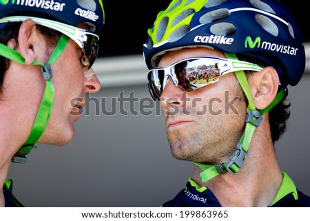 LECTOURE, FRANCE - JUNE 20: Spanish cyclist Alejandro Valverde talking with Jesus Herrada at the departure of the first stage of the Route du Sud, on June 20, 2014 in Lectoure, France.  - stock photo