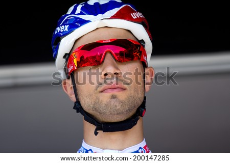 LECTOURE, FRANCE - JUNE 20   The french cyclist Nacer Bouhanni at the departure of the first stage of the Route du Sud, on June 20, 2014 in Lectoure, France.   - stock photo
