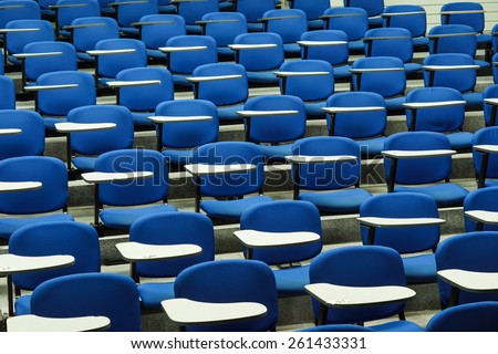 Lecture chairs in a class room - stock photo