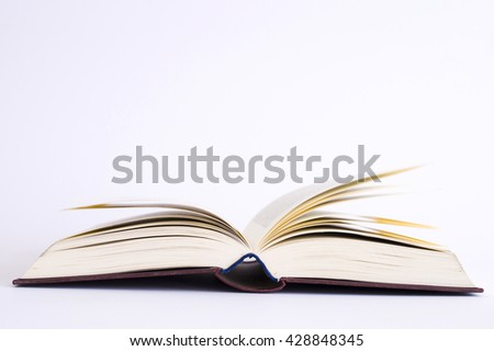 lecture - close up of a book - isolated on white background - studio shot - natural light