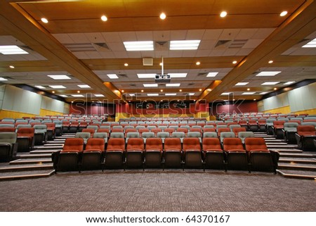 Lecture hall with colorful chairs - stock photo