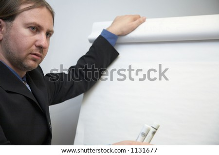 Lecturer and whiteboard - stock photo