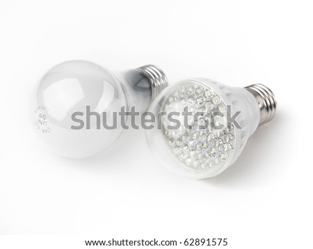 LED and a regular incandescent light bulbs isolated on white background - stock photo