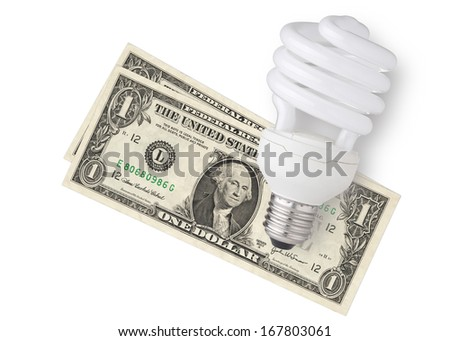 LED bulb over dollar bills isolated on white background