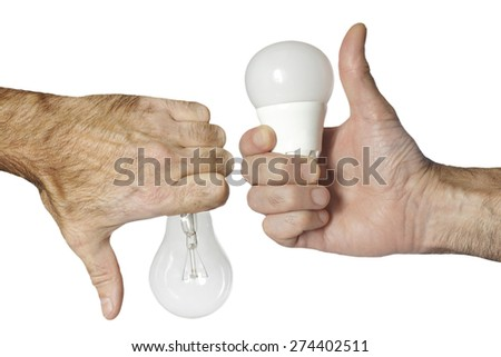 led bulb versus incandescence bulb isolated with clipping path - stock photo