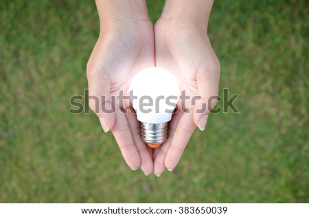 LED bulb with lighting in human - saving technology - stock photo