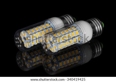 LED corn lamp on a black background with reflection - stock photo