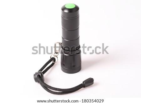 LED flashlight on white background - stock photo