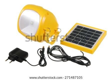 Led flashlight with mini solar panel on the white background - stock photo