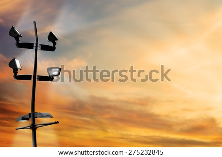 LED Flood Light on Early in the Evening Twilight Time and Rays of Sunset in Right - Texture Background Left - stock photo