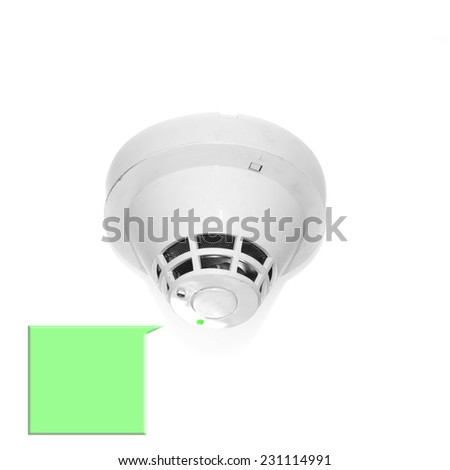 Led green show Smoke detector mounted on ceiling and text. - stock photo