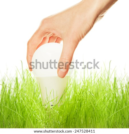 LED lamp in green grass - stock photo