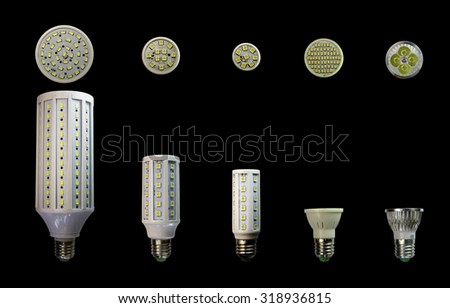 LED lamp isolated on a black  background  with clipping path. Closeup with no shadows.  A collection of lamps. Energy-saving technology. The lamp with a conventional socket.  - stock photo