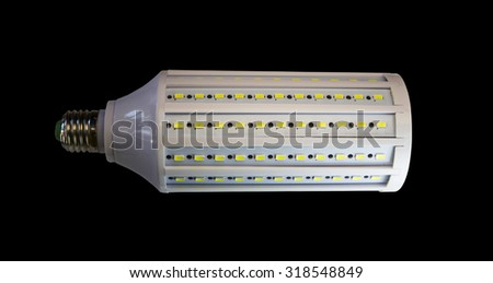 LED lamp isolated on a black  background  with clipping path. Closeup with no shadows.  50 watts.  Energy-saving technology. The lamp with a conventional socket.  - stock photo