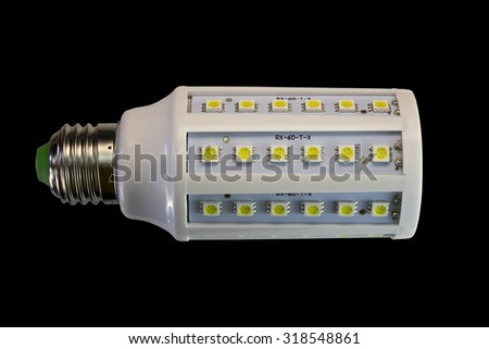 LED lamp isolated on a black  background  with clipping path. Closeup with no shadows.  12 watts.  Energy-saving technology. The lamp with a conventional socket.  - stock photo