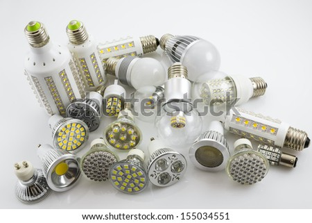 LED lamps GU10 and E27  with a different chip technology also construction, different lamp power and cover glass - stock photo