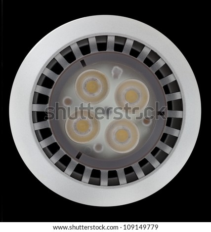 LED Light bulb illuminated and taken from above and isolated against black - stock photo