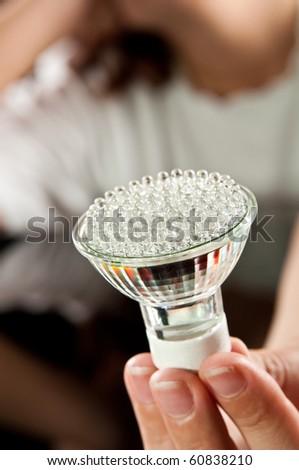 led light bulb in hand - stock photo