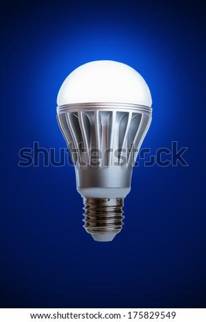 LED light bulb isolated on a blue background - stock photo
