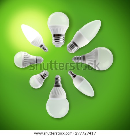 LED light bulbs in a circle with a glowing bulb, concept of diversity, teamwork, leadership and idea. Standing out from the crowd in a round table conference.