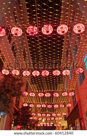 LED overhead netting and lantern decoration. Concept of energy saving, cool lighting and decoration. - stock photo