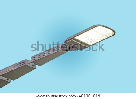 LED street lamps post on blue sky background - stock photo