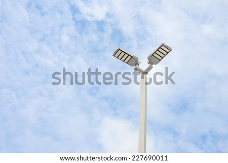 LED street lamps with energy-saving technology, cloud on sky background - stock photo