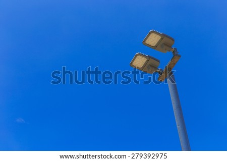 LED street lamps with energy-saving technology, on sky background - stock photo