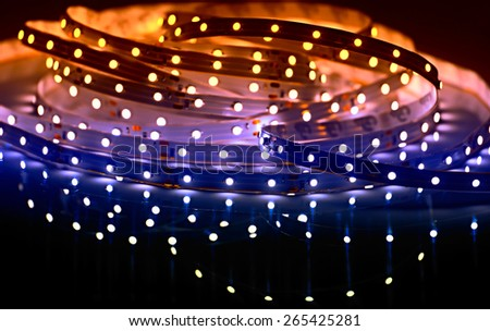 Led strip closeup. Diode crystals. Glowing electrical strip. - stock photo