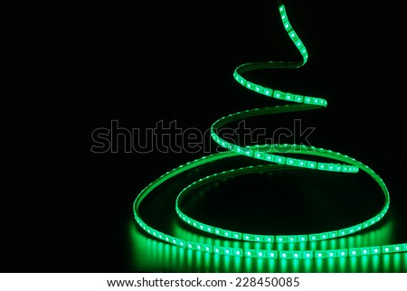 Led stripe as Christmas tree is isolated on the black background - stock photo