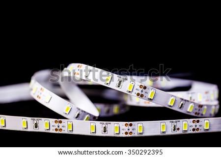 Led stripe light on black background - stock photo