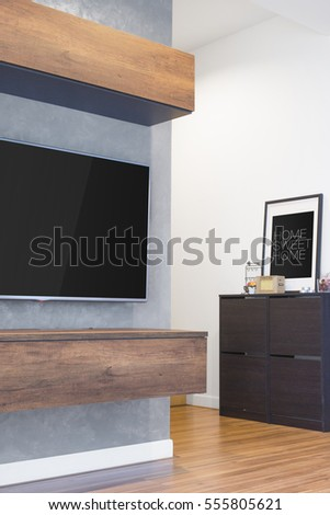 Led TV Hang On The Cement Wall With Wood Cabinet Furniture And Hard Wood  Laminate Floor